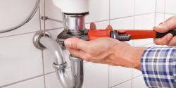 Residential Plumbing - Deerfield Pplumber repairing bathroom sink